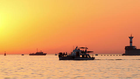 Boats floating on the sea at sunset Footage