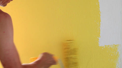 Painting wall in yellow color Filmmaterial
