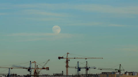 The moon in the sky over a building site Footage