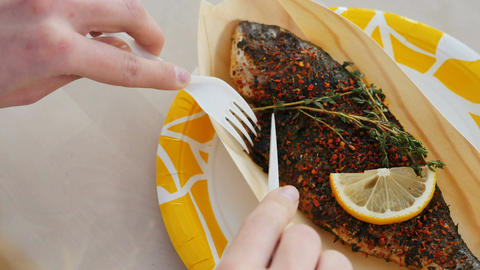 Macro Woman Eats Roasted Fish Sprinkled Grass with Lemon Footage