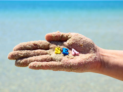 human hand in the sand Photo