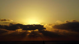 Deep amber sunset with clouds, time lapse Footage