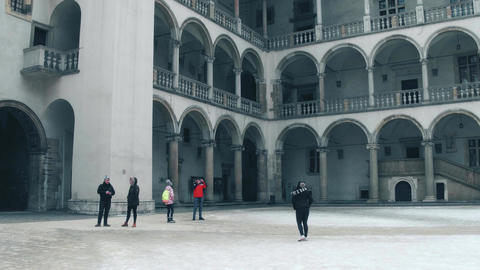 KRAKOW, POLAND - JANUARY, 14, 2017 Steadicam shot of tourists making photos at Footage