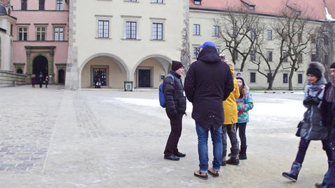 KRAKOW, POLAND - JANUARY, 14, 2017 Steadicam shot of guided family group tour at Footage