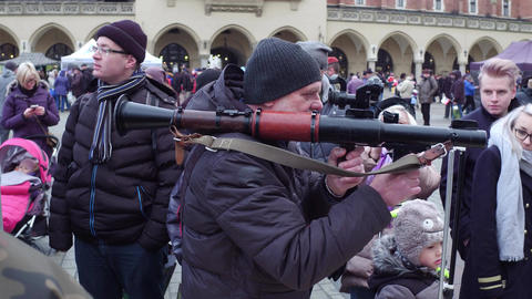 KRAKOW, POLAND - JANUARY, 14, 2017 Man examines RPG grenade launcher at military Footage
