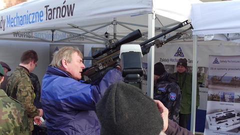 KRAKOW, POLAND - JANUARY, 14, 2017 Man examines army sniper rifle at military Footage