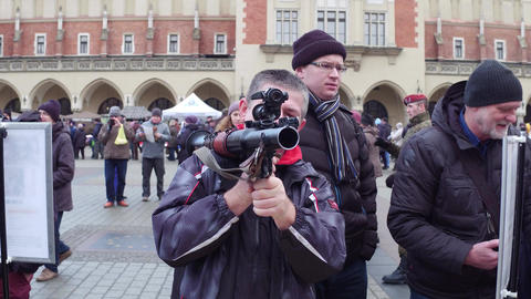 KRAKOW, POLAND - JANUARY, 14, 2017 Man examines grenade launcher at military Footage