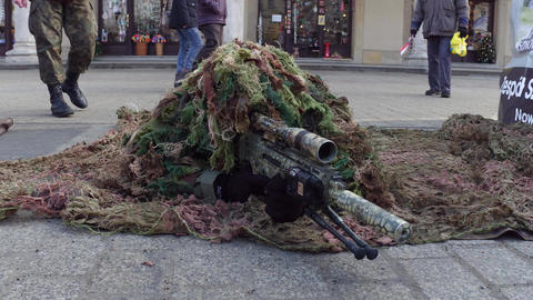 KRAKOW, POLAND - JANUARY, 14, 2017 Special force sniper wearing disguise Live Action