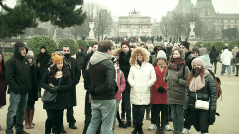 PARIS, FRANCE - DECEMBER, 31, 2016. Group of multiethnic tourists and tour guide Footage