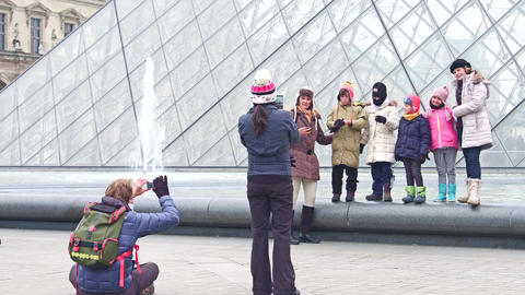 PARIS, FRANCE - DECEMBER, 31, 2016. Cheerful family posing and making photos Footage