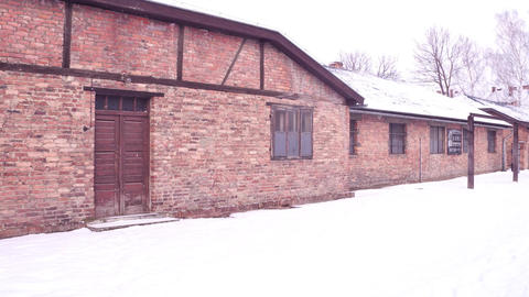Steadicam shot of concentration camp brick building in winter Footage