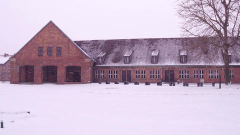 Steadicam shot of concentration camp brick building in winter. 4K video Footage