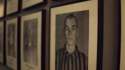 OSWIENCIM, POLAND - JANUARY, 14, 2017 Steadicam shot of portraits of Auschwitz Footage