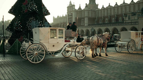 KRAKOW, POLAND - JANUARY, 14, 2017 Steadicam shot of retro horse drawn carriages Footage