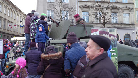 KRAKOW, POLAND - JANUARY, 14, 2017 People examine HMMWV armored vehicle at WOSP Footage