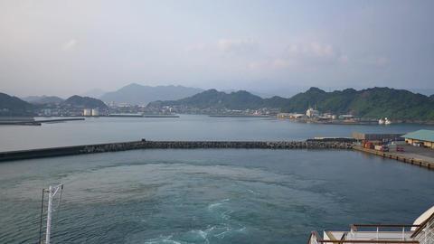 shot of cruise ship leaving aburatsu port of miyazaki prefecture Footage