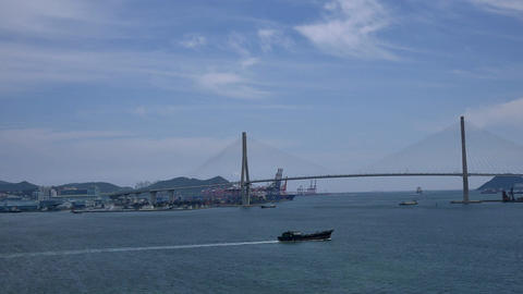 shot of ship sailing toward busan bridge Footage