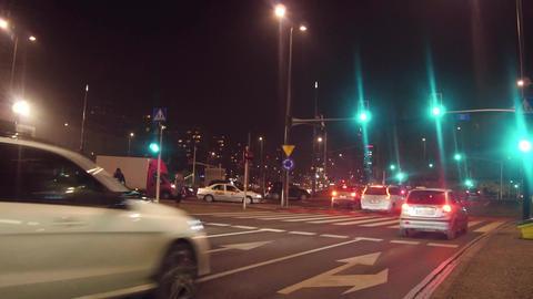 WARSAW, POLAND - DECEMBER, 22, 2016. Traffic lights changing color above urban Footage