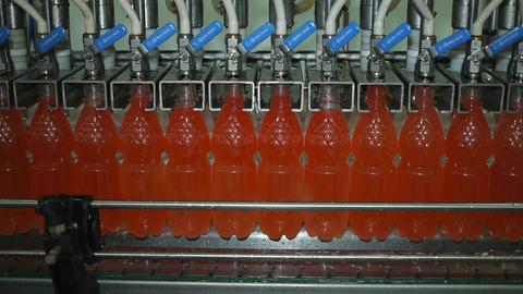Bottling of lemonade in plastic bottles. Lemonade bottle conveyor industry Image