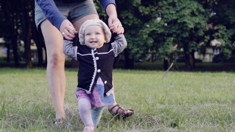 A baby is making the first steps Footage