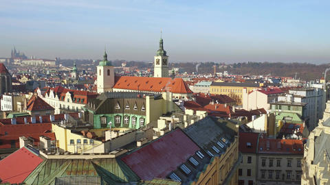 Tiled roofs and gothic spires of old town of Prague on a sunny day Footage