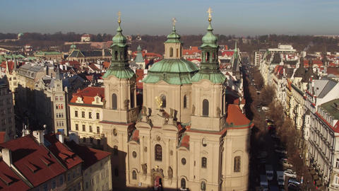The Church of Saint Nicholas and tiled roofs old town in Prague on a sunny day Footage