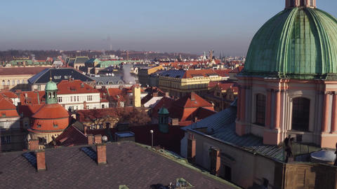 Roofs and gothic spires of old town and distant Prague castle Footage