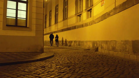 Couple walking on old town street in Prague at night Archivo