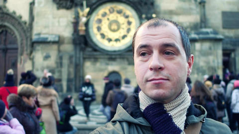 Male tourist on crowded square in Prague near Astronomical clock Footage