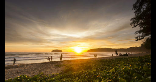 Time - lapse Activities on the beach with colorful sunset at sunset time , Footage