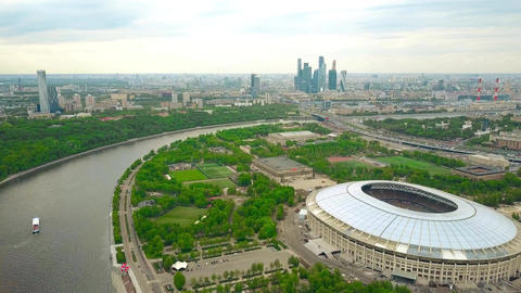 Moscow cityscape involving Luzhniki football stadium and distant business center Footage