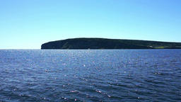 View from moving boat on Bonaventure Island coast cliffs in Gaspe, Quebec Footage