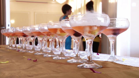 Champagne glasses on a table located in hall party in which alcohol vapors out Live Action