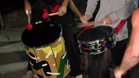 Drummers singing at a show beat the rhythm in their drums 08d Live Action