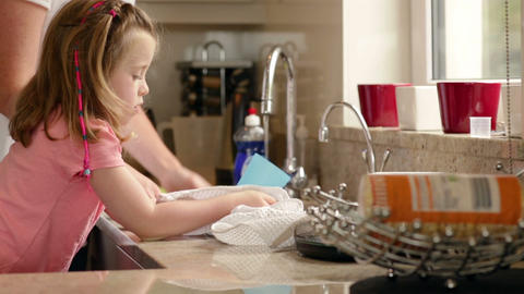 Mother and daughter washing up Footage
