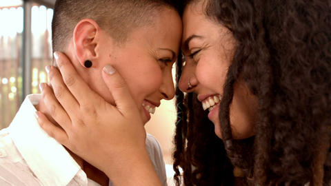 Happy lesbian couple smiling face to face Footage
