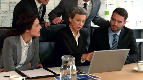 Business people looking at laptop Footage