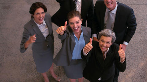 Happy business team showing thumbs up Footage
