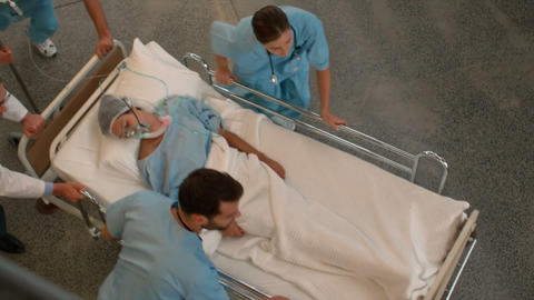 Medical team carrying a patient to intensive care unit Footage