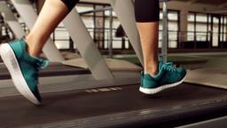 Woman running on treadmill Footage