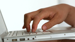Masculine hand typing on laptop keyboard Live Action