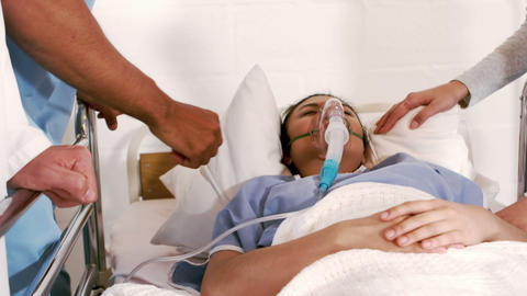 Patient receiving oxygen mask from medical team Footage