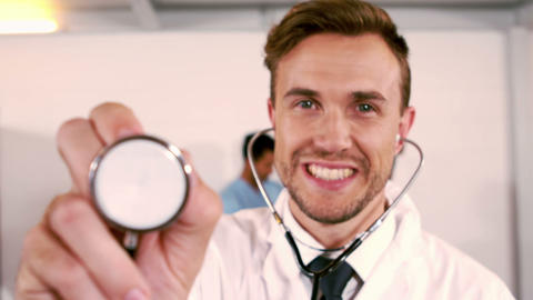 Portrait of a doctor holding stethoscope Footage