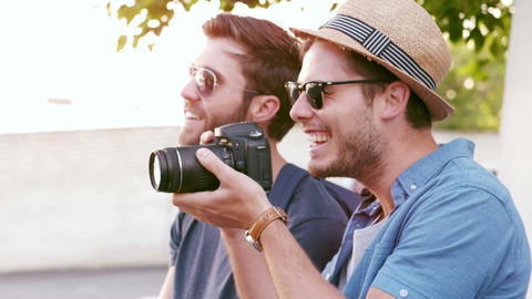 Hipster friends taking pictures with an old camera Footage