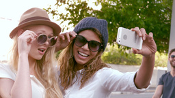 Smiling attractive friends taking selfie Footage