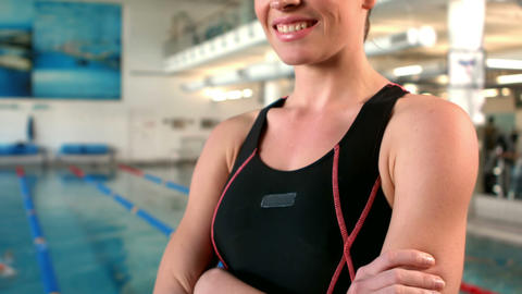 Smiling woman swimmer with arms crossed Footage