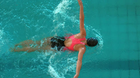 Fit woman swimming in the swimming pool Live Action