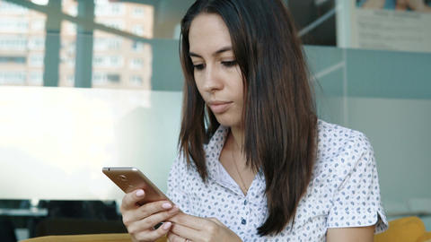Young smiling woman using smartphone Footage
