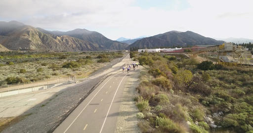 Trail cycling with mountain backdrop Footage