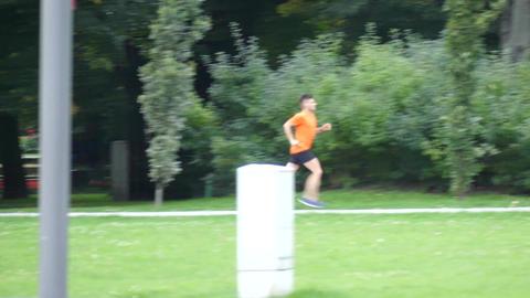 WARSAW, POLAND - SEPTEMBER 14, 2017. Male runner running in city park Footage